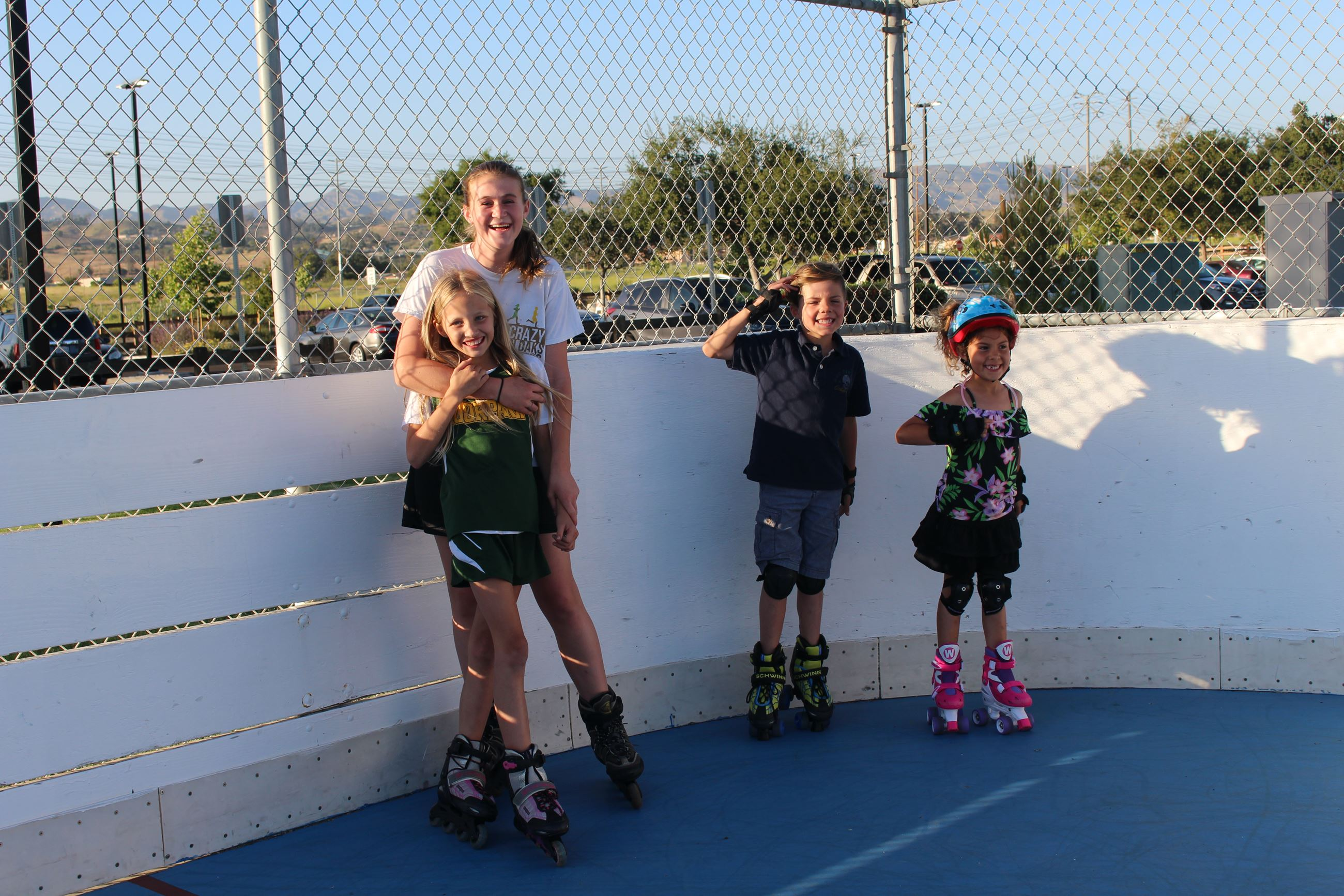 4 children roller skating