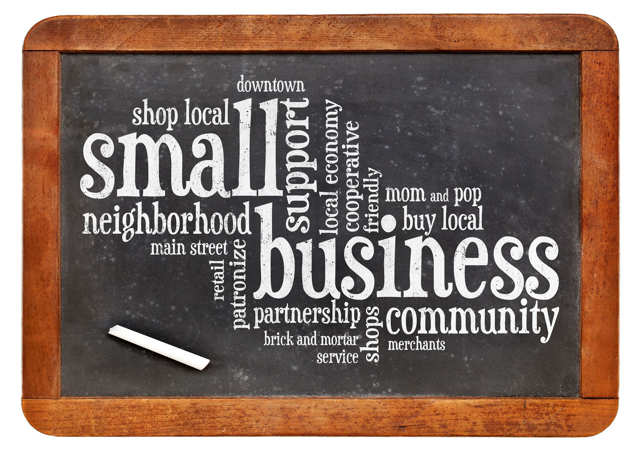 wooden chalk board with words about shopping locally